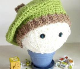 Crochet kids tam hat in green and oatmeal