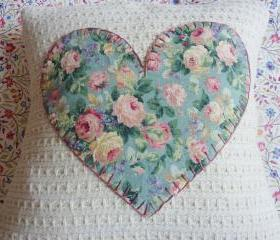 Hand made cushion with vintage heart detail.