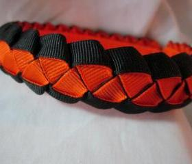 Braided ribbon headband in orange and black