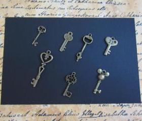 Seven Antique Bronze Key Charms