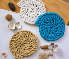 Recycled T-shirt fabric crocheted shell shaped coasters: white, blue, light brown.