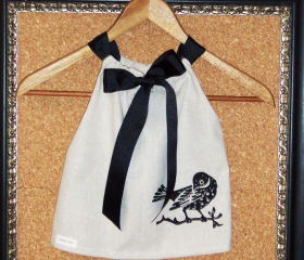 Girls dress in taupe cotton and black bird screen print with a black gros grain ribbon adjust to fit