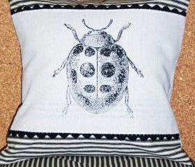 Decorative throw pillow cushion cover with lady bug screen print in black