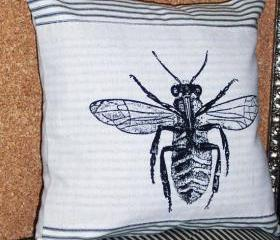 Decorative throw pillow with bee screen print design