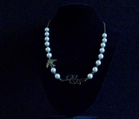 Necklace Bronze tree branch with swallow and white swarovski glass pearls