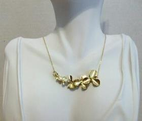 Delicate Gold Cascading Orchid Necklace