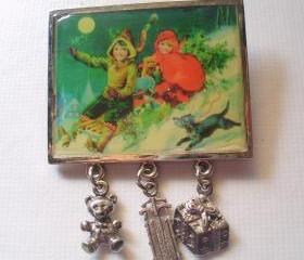 vintage christmas picture pin, children sledding with charm dangles