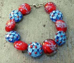 red and turquoise lampworked art bead bracelet