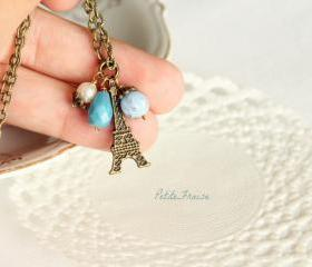 In the foggy sky, Eiffel Paris necklace, in blue, dusty blue, vintage style