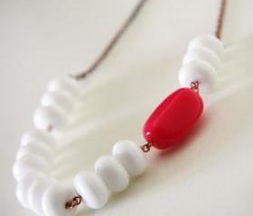 white and neon pink necklace - colorblock summer trend