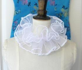 White organza pierette neck ruffle.
