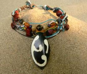 Surfer bracelet with bone pendant