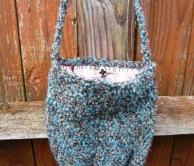large side sash crochet purse in turquoise neutral with pink flannel birds lining