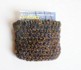 small crochet wallet/card pouch with floral/butterfly lining.