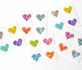 20 round glossy stickers with colorful hearts