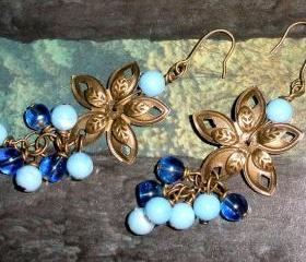 Bronze flower earrings with blue beads