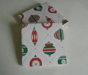 Set of 4 sealed Christmas tree print tile coasters with felt pads.