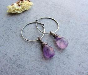 Oxidized sterling silver hoop earrings with a purple amethyst teardrop gemstones.