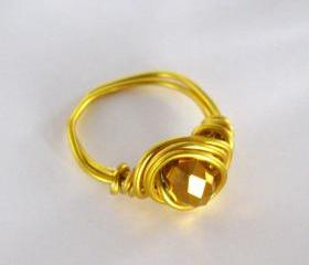 Pick your size: Gold wire wrapped ring with bronze bead