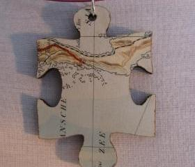 lasercut wooden map pendants - piece of the world