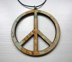 lasercut wooden map pendants - world-peace