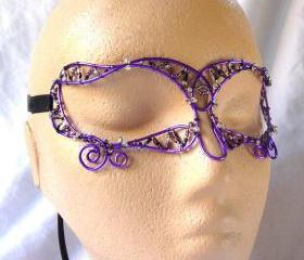 Ladies masquerade mask in purple