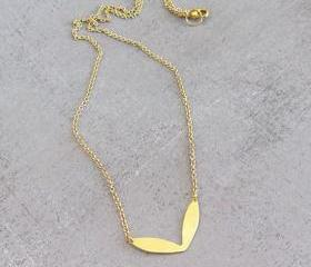 Simple dainty gold necklace, tiny raw brass leaf