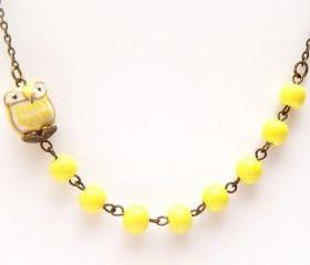 Antiqued Brass Yellow Porcelain Round Bead Owl Necklace