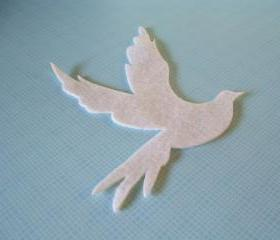 Flying dove on white felt