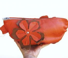 Medium sized orange Leather Clutch with flower applique on both sides