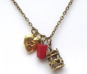 Antiqued Brass Locket Carrousel Coral Necklace