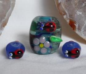 Handmade Glass Lampwork bead - Lady beetle and flowers