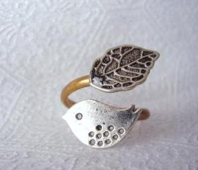 silver bird ring with a leaf open warp style