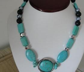 Pretty Turquoise and Silver and Black Accents on an Adjustable Necklace