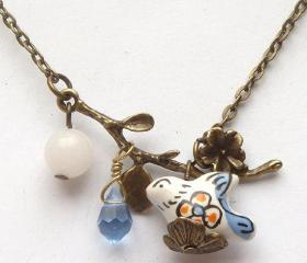 Antiqued Brass Leaf White Jade Quartz Porcelain Bird Necklace
