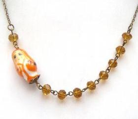 Antiqued Brass Yellow Quartz Porcelain Matryoshka Necklace