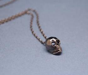 Cute Tiny Baby Skull Necklace in gunmetal