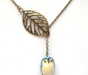 Antiqued Brass Leaf Blue Owl Necklace