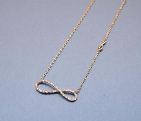Infinity Knot Necklace with CZ crystals in Gold