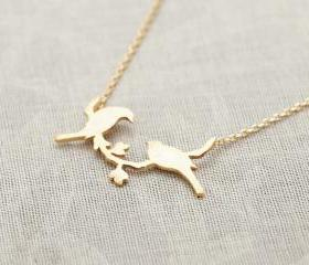bird on a branch necklace in gold
