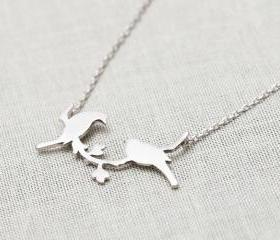 bird on a branch necklace in Silver