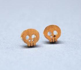 Tiny skull face studs earrings in matte gold
