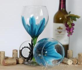 Wild flower painted wine glass in cerulean blue that is dishwasher safe