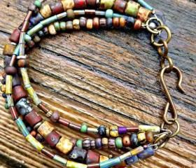 Customization. Multi-strand Bohemian, hippie bracelet. Earth tone. Picasso Czech seed bead glass Jewelry. Bracelet. Brown. Glass and metal