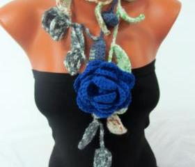 Knitted scarf necklace, flower necklace with green multicolor and blue rose