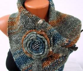 Knitted scarf around the neck, three buttons, crocheted flower with beads in killed, earthy colors