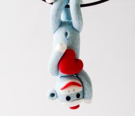 Blue Sock Monkey Pendant Swinging Upside Down holding a Valentine's Day Heart 