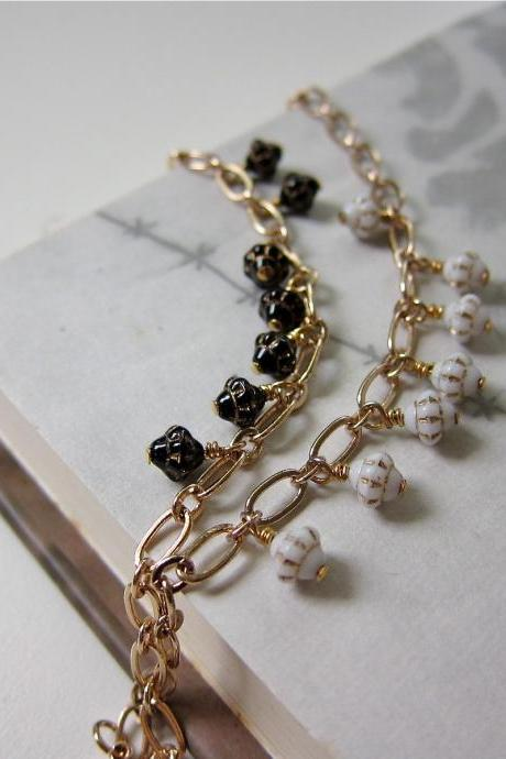 Saturn bracelet - rose gold chain with vintage glass (in black)