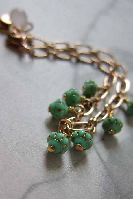 Saturn bracelet - rose gold chain with vintage glass (in mint green)