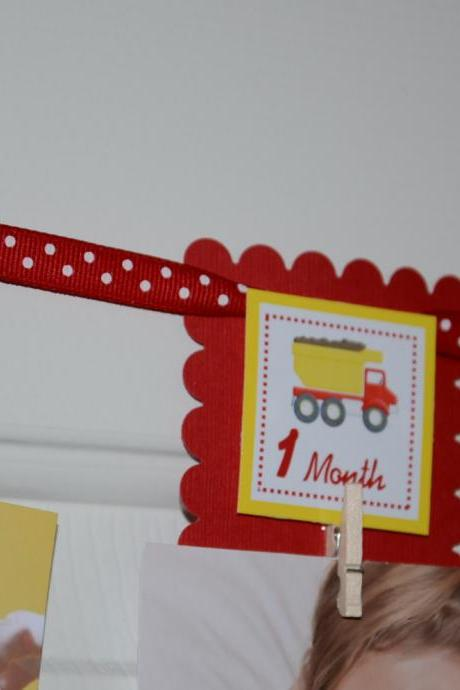 First Year Photo Clips, First Year Banner, Dump Truck Construction Theme, Red, Blue and Yellow color.